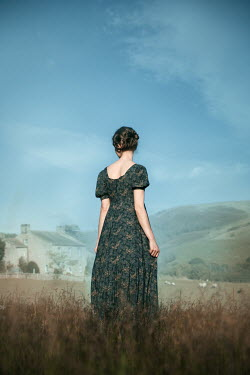 Natasza Fiedotjew Historical young woman looking at house in hills
