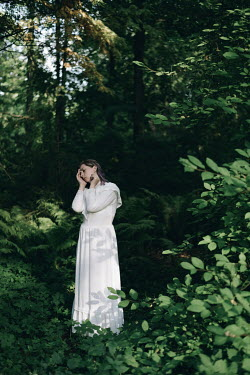 Alina Zhidovinova SAD WOMAN IN WHITE DRESS IN FOREST Women