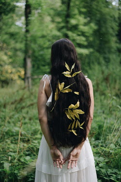 Alina Zhidovinova WOMAN WITH LEAVES IN HAIR IN COUNTRYSIDE Women