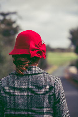 Marie Carr WOMAN IN COAT AND RED HAT ON COUNTRY ROAD Women