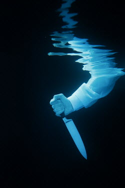 Magdalena Russocka MALE HAND HOLDING KNIFE UNDERWATER Men