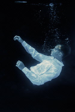 Magdalena Russocka teenage boy floating underwater
