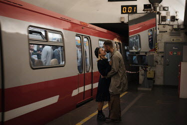 Alina Zhidovinova COUPLE EMBRACING ON PLATFORM BY TRAIN Couples
