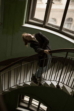 Alina Zhidovinova DREAMY GIRL ON STAIRCASE INSIDE BUILDING Women