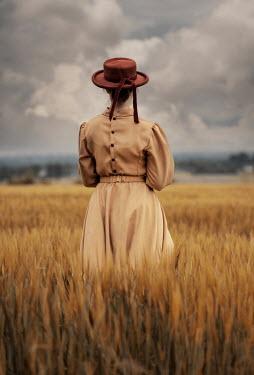 Jaroslaw Blaminsky WOMAN IN HAT STANDING IN WHEAT FIELD Women