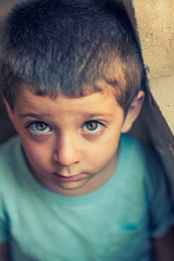 Mohamad Itani STARING LITTLE BOY WITH BROWN HAIR FROM ABOVE Children