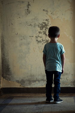 Mohamad Itani LITTLE BOY STANDING IN SHABBY BUILDING Children