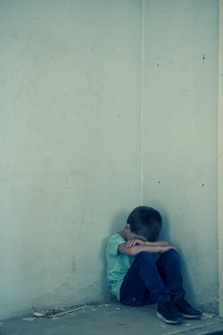 Mohamad Itani SAD LITTLE BOY SITTING IN CORNER OF SHABBY ROOM Children