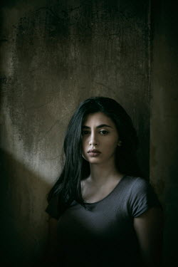 Mohamad Itani SAD WOMAN WITH LONG DARK HAIR IN SHABBY ROOM Women