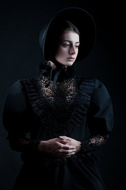 Magdalena Russocka victorian woman in black wearing bonnet