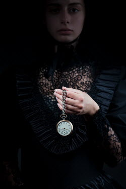 Magdalena Russocka VICTORIAN WOMAN IN BLACK HOLDING WATCH ON CHAIN Women