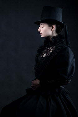 Magdalena Russocka victorian woman in black wearing top-hat