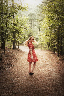 Buffy Cooper BLONDE WOMAN IN RED DRESS ON COUNTRY PATH Women