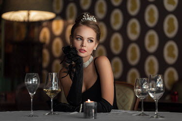 Maxim Guselnikov ELEGANT WOMAN WITH GLASS OF WINE SITTING IN RESTAURANT Women