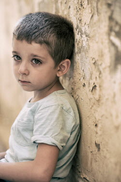 Mohamad Itani SAD LITTLE BOY SITTING IN SHABBY ROOM Children