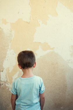 Mohamad Itani LITTLE BOY FACING WALL IN SHABBY ROOM Children
