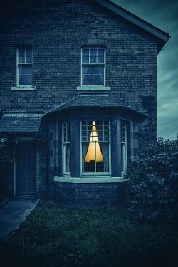 Natasza Fiedotjew light in window of house at night