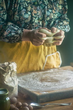 Natasza Fiedotjew ELDERLY WOMAN ROLLING PASTRY IN KITCHEN Old People