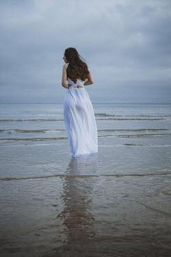 Shelley Richmond BRUNETTE WOMAN WITH WHITE DRESS IN SEA Women