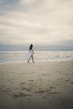 Shelley Richmond BRUNETTE WOMAN WITH WHITE DRESS WALKING BY SEA Women