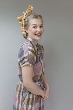 Shelley Richmond HAPPY BLONDE GIRL IN PATTERNED DRESS AND HEADSCARF Women