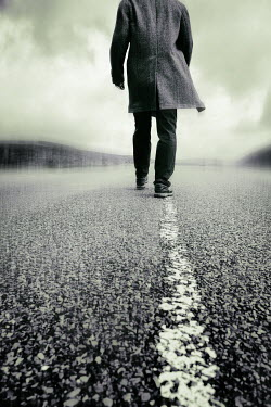 Tim Robinson MAN IN COAT WALKING ON COUNTRY ROAD Men