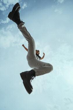 Greta Larosa JUMPING GIRL WITH BLUE SKY FROM BELOW Women