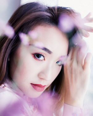 Jessica Lia ASIAN WOMAN WITH BLURRED PURPLE FLOWERS Women