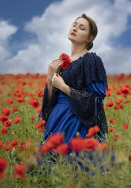 Jaroslaw Blaminsky HISTORICAL WOMAN HOLDING POPPY IN FIELD Women