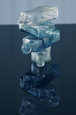 Liz Dalziel STACK OF BLUE AND WHITE GLASS BOTTLES Miscellaneous Objects