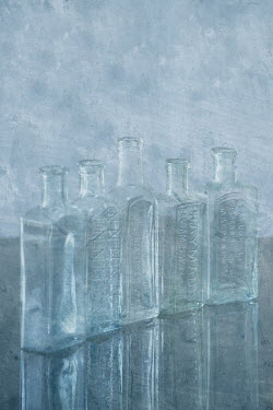 Liz Dalziel LINE OF SMALL GLASS BOTTLES Miscellaneous Objects