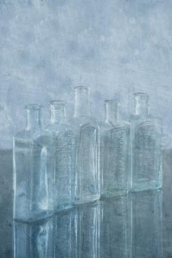 Liz Dalziel LINE OF SMALL GLASS BOTTLES Miscellaneous Objects