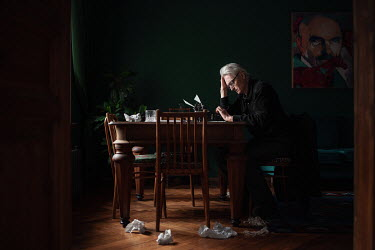 Maxim Guselnikov MAN WITH GRAY HAIR SITTING AT TYPEWRITER Old People