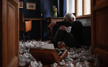Maxim Guselnikov MAN SITTING WITH BALLS OF PAPER ON FLOOR Old People