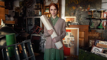 Maxim Guselnikov WOMAN HOLDING ROLL OF PAPER IN JUNK SHOP Women