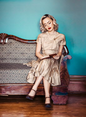 Elisabeth Ansley BLONDE WOMAN IN DRESS SITTING READING INDOORS Women