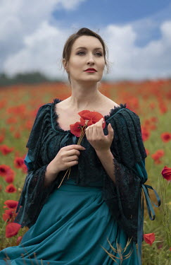 Jaroslaw Blaminsky WOMAN IN LACY DRESS HOLDING POPPIES IN FIELD Women