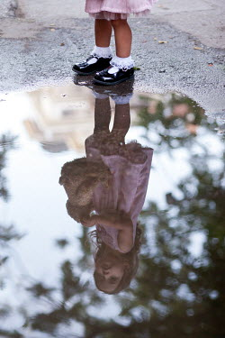 Kerstin Marinov LITTLE GIRL WITH TEDDY REFLECTED IN PUDDLE Children