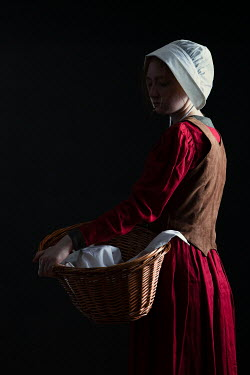 Magdalena Russocka historical woman servant with laundry basket inside