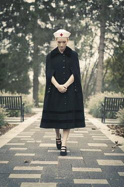 Robin Macmillan NURSE IN CAPE WALKING IN PARK Women