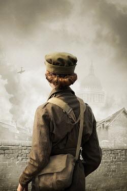 Stephen Mulcahey WOMAN IN MILITARY UNIFORM WATCHING LONDON BOMBING Women