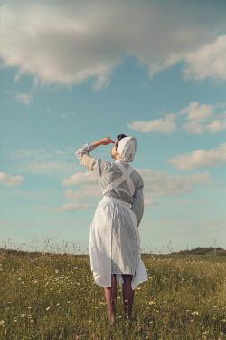 Joanna Czogala WARTIME NURSE WATCHING SKY IN COUNTRYSIDE Women