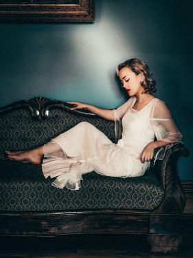 Elisabeth Ansley BAREFOOT WOMAN IN WHITE LYING ON SOFA Women