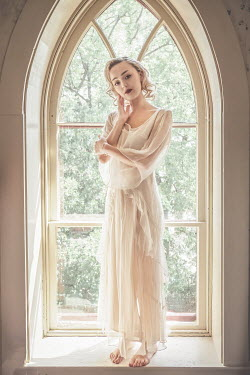 Elisabeth Ansley BLONDE WOMAN IN WHITE SITTING IN WINDOW Women