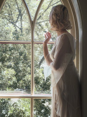 Elisabeth Ansley BLONDE WOMAN AT WINDOW WATCHING GARDEN Women