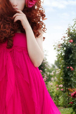 ILINA SIMEONOVA WOMAN IN PINK WITH RED HAIR IN GARDEN Women