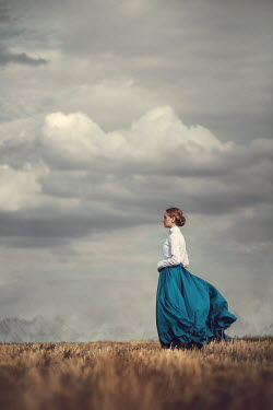 Magdalena Russocka historical woman standing in field Women