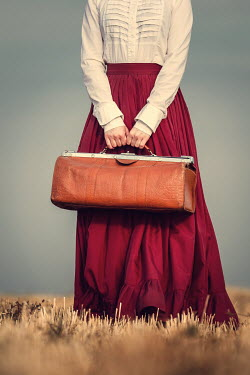 Magdalena Russocka HISTORICAL WOMAN CARRYING BAG IN FIELD Women