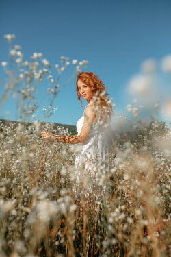 Nina Masic GIRL WITH RED HAIR IN FIELD OF FLOWERS Women