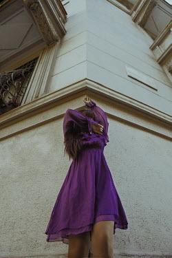 Greta Larosa WOMAN COVERING FACE OUTSIDE BUILDING Women